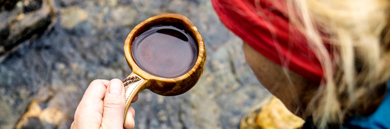 Drinking water from wooden cup