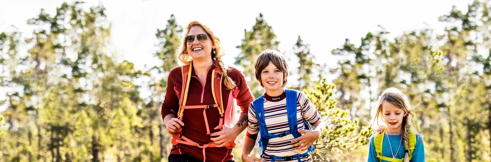 Family of three hiking in Värmland