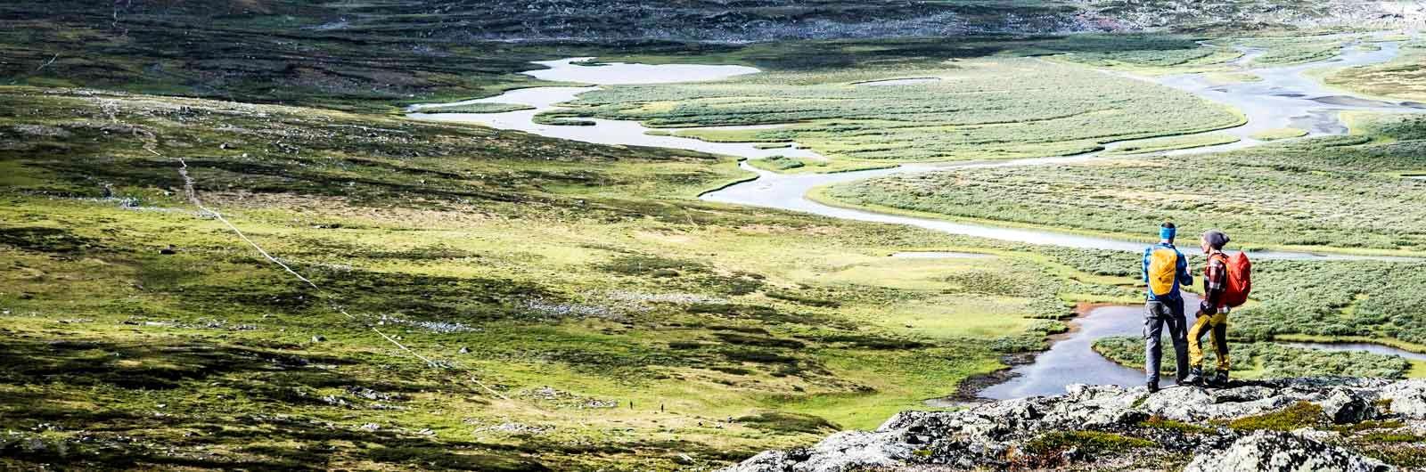 Hikers above river delta on Kungsleden Trail