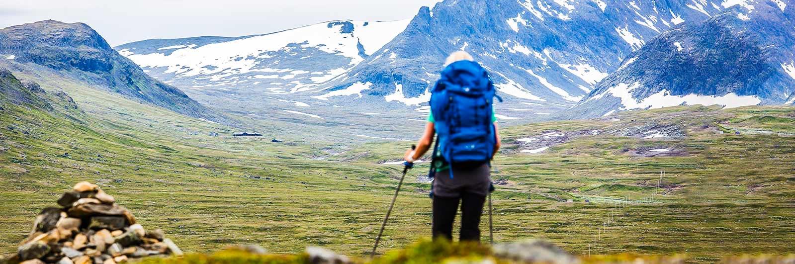 Hiker with blue rucksack in Jämtland
