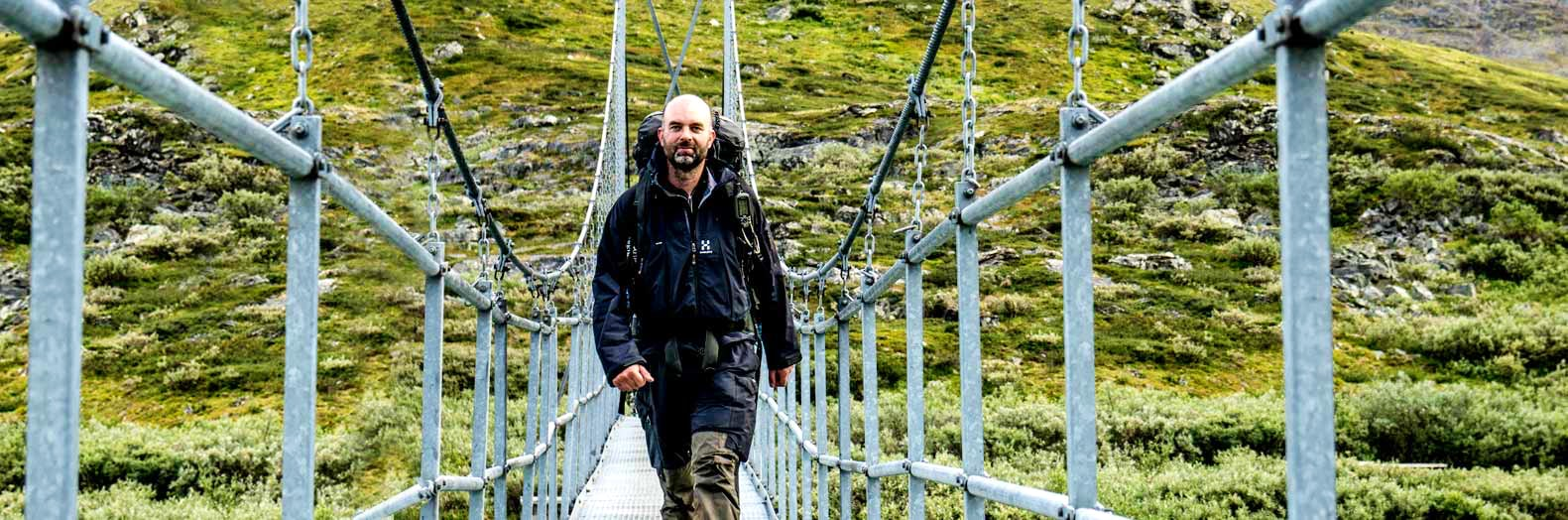man on bridge near STF Tärnasjö mountain cabin