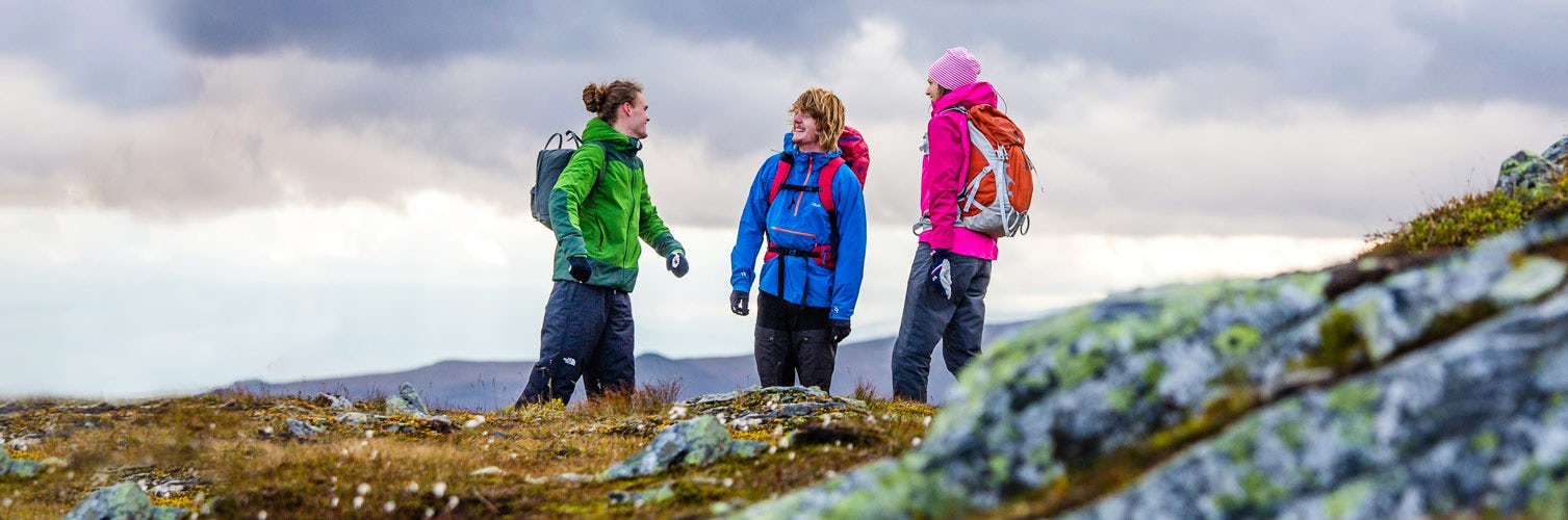 Mountain hikers with colourful jackets