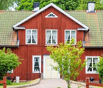 Hostel in a red wooden house