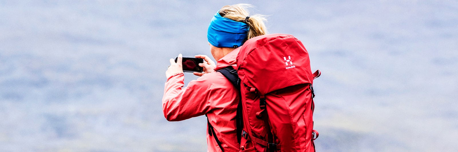 Woman taking a photo on hike through Ammarnäs-Aigert