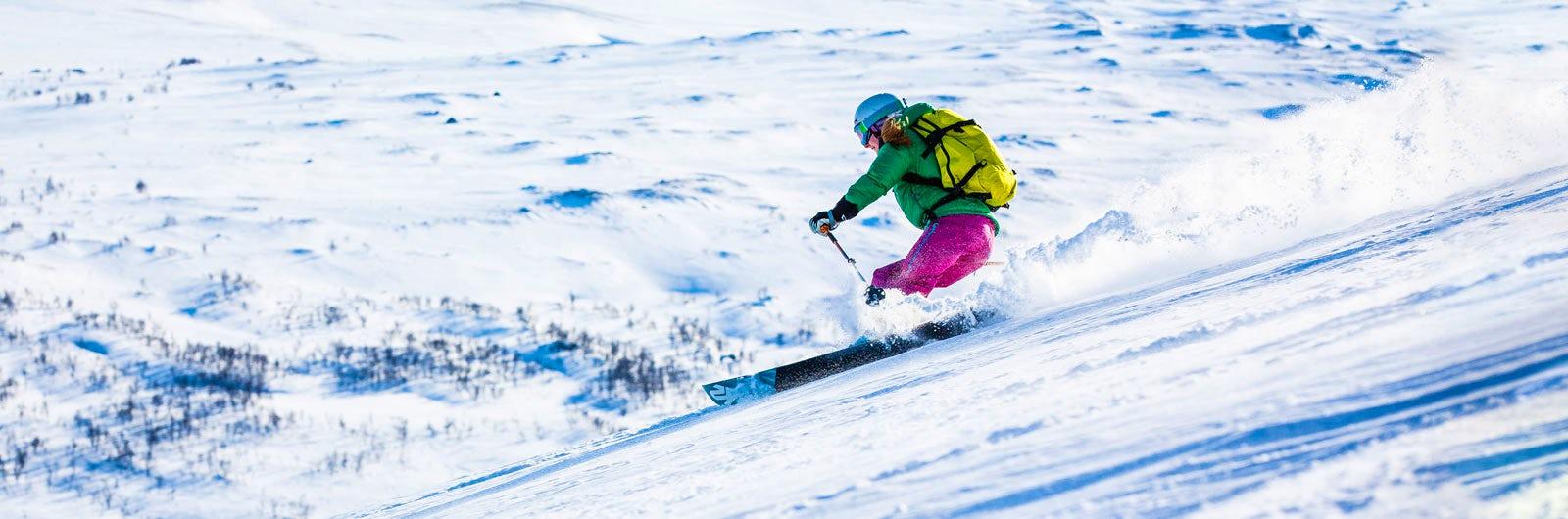 Skiing on steep mountain slope