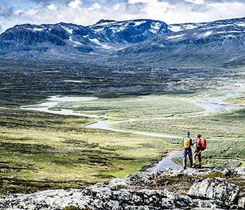 Hikers looking at Abisko river delta