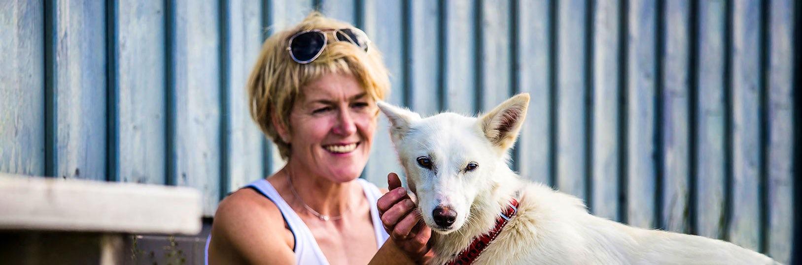 Woman hiking with dog