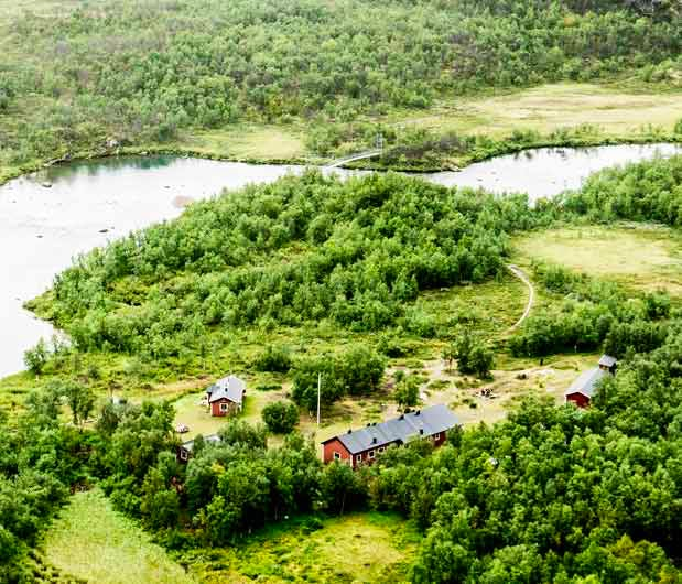Mountain cabins and river seen from above