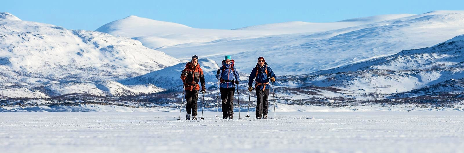 Three friends skiing in the mountains