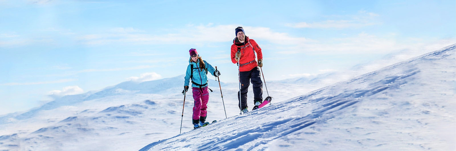 Couple summit skiing