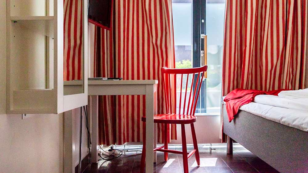 Single room with striped curtains
